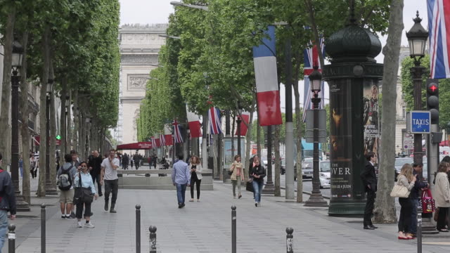 french and british flags on avenue des champs elysees, paris, france, europe - avenue des champs elysees stock videos & royalty-free footage