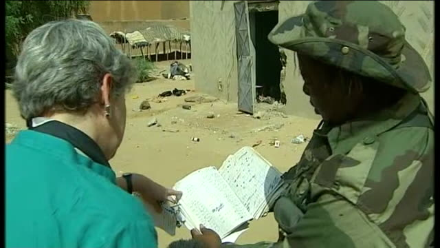 french and malian troops retake timbuktu from islamists mali ext soldier outside building pan barrels barrels with cables sticking out debris on... - sachet stock videos & royalty-free footage