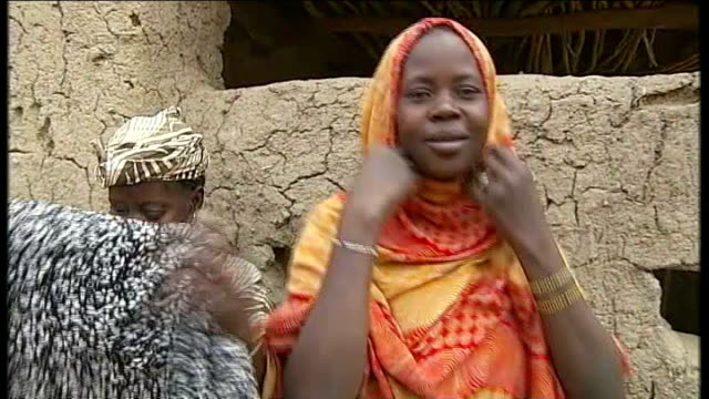 french and malian troops retake timbuktu from islamists women showing how they had to wear hijab then throwing it away women celebrating - religiöse kleidung stock-videos und b-roll-filmmaterial