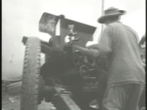 french army artillery regiment firing artillery cannons explosions in the distance straw house burning on fire vs large group of communist chinese... - regiment stock videos and b-roll footage