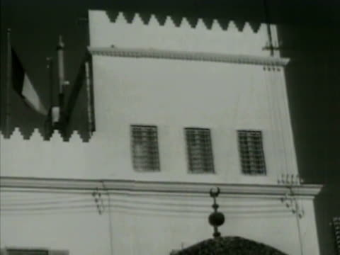 french army building tunis la ms tunisian arab guarding entrance sign bg int ms french air force officers looking over maps ext ms army officers... - 1942 stock videos and b-roll footage