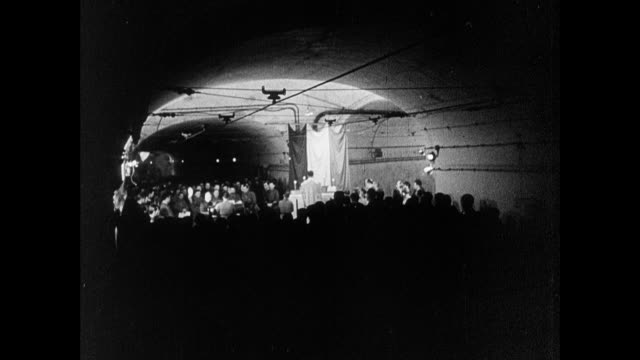 montage french army soldiers celebrating christmas mass in a munitions tunnel of the maginot line / strasbourg, france - in silhouette stock videos & royalty-free footage