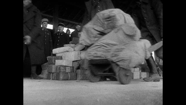 montage french army soldiers hauling mail bags, and unloading and sorting through parcels / strasbourg, france - maginot linie stock-videos und b-roll-filmmaterial