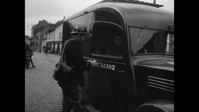 montage french army soldiers patrolling empty city and checking papers of last truck leaving / strasbourg, france - maginot linie stock-videos und b-roll-filmmaterial