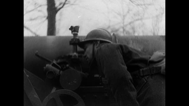 stockvideo's en b-roll-footage met montage french army soldiers readying and firing massive field guns along the maginot line / strasbourg, france - 1940