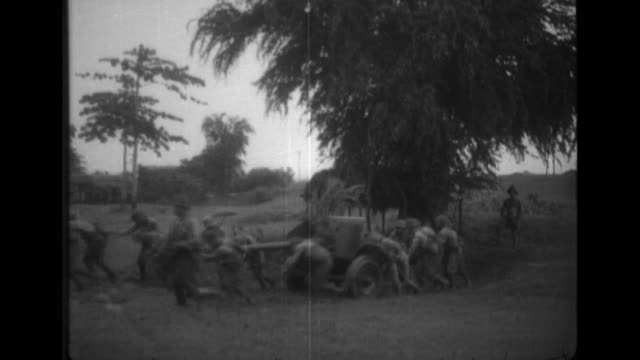 french artillery officers watch the imperial japanese army's asakuno unit use type90 fieldguns during a live fire drill in southern french indochina - indocina video stock e b–roll