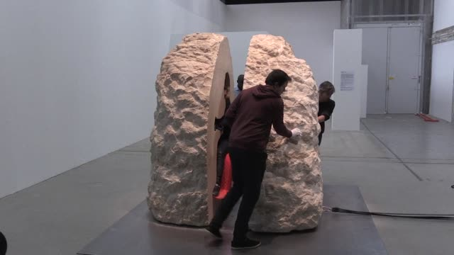"""french artist emerged a little stunned"""" on wednesday from a week entombed inside a 12-tonne rock and thanked it for having made him feel so welcome - boulder rock video stock e b–roll"""