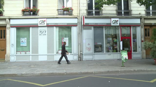 french banking group credit agricole is to cut 2350 jobs around the world including 850 positions in france mainly at its cacib investment bank the... - cut video transition stock videos and b-roll footage