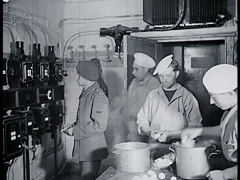 french chefs cooking in kitchen steam. chef inspecting meat. chefs working manning machine. soldier adjusting knob. chefs in kitchen. chef cutting... - maginot linie stock-videos und b-roll-filmmaterial