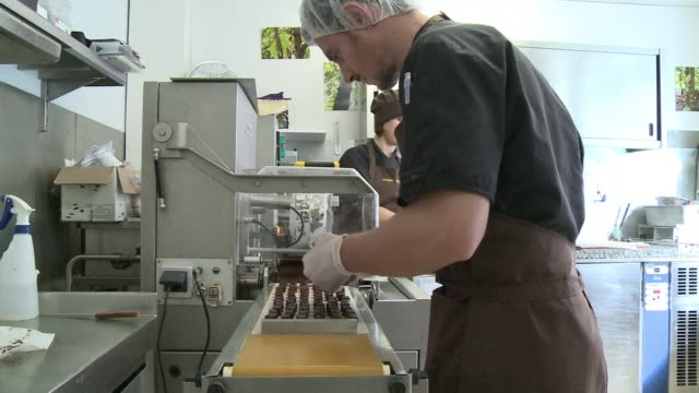 french chocolate makers are developing a passion for raw chocolate hailed as a new superfood which is made with unroasted cocoa beans - antioxidant stock videos & royalty-free footage