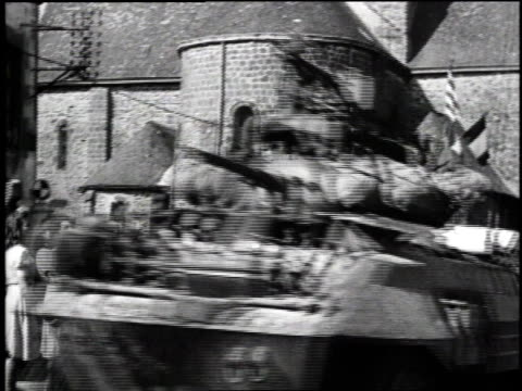French citizens waving to soldiers in trucks and tanks / soldiers waving from tanks