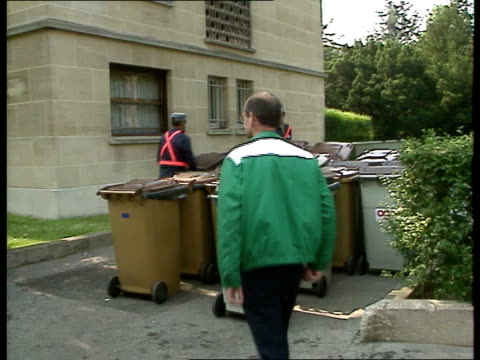 stockvideo's en b-roll-footage met french company take over refuse collection in derbyshire / refuse collection in paris france neuilly dustcarts parked in street / sign on van... - derbyshire