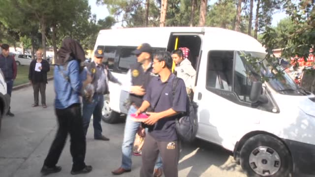 French couple and 5 Indonesians are seen being detained after allegedly arriving in Turkey's Adana to join DAESH on November 7 2015