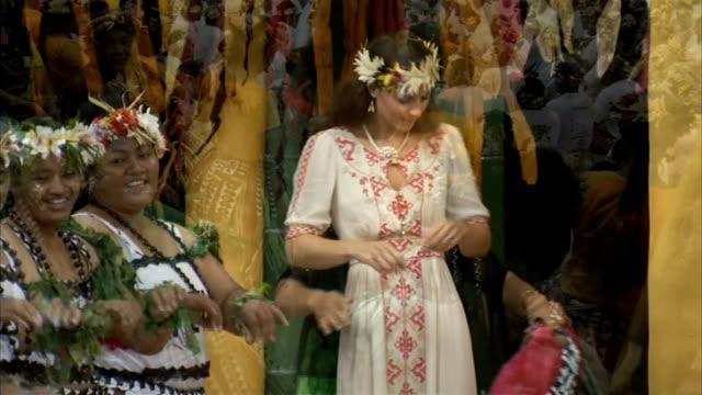 french court grants injunction on topless duchess of cambridge photographs tuvalu ext catherine duchess of cambridge spraying perfume on dancers in... - französisch polynesien stock-videos und b-roll-filmmaterial