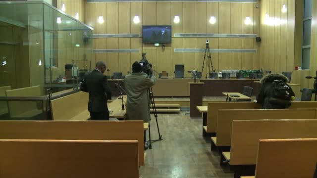 a french court on begins hearing the landmark trial of a former rwandan army captain charged with complicity in the 1994 genocide that left 800000... - court hearing stock videos & royalty-free footage