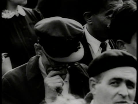 vidéos et rushes de french crowd gathered around large van speaker vs cu french people standing in crowd talking crying ms crowd listening loud speaker fg cu old man... - 1941