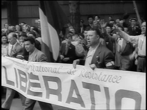 French crowd with banners marching in streets / Liberation of Paris / documentary
