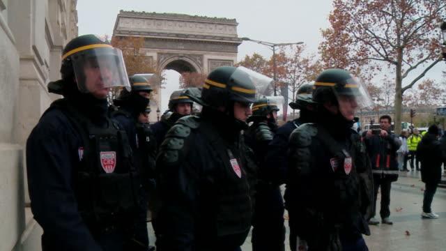 French CRS riot police Compagnies Républicaines de Sécurité at the Gilets Jaunes protest on the ChampsÉlysées in Paris Shots of riot police officers...