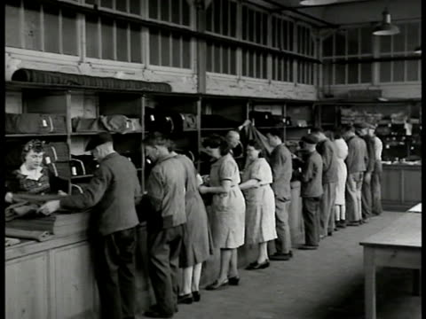 stockvideo's en b-roll-footage met french customers buying textile in shop shelves of material cloth workers behind counter la ms people at counter examining material talking w/ worker... - 1946