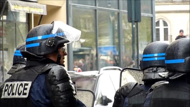 french demonstrators protesting a labour reform bill clash with police in the western city of rennes as around 10 people were arrested in paris... - rennes stock videos & royalty-free footage