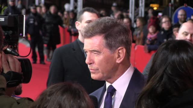 french directo pascal chaumeil graced the red carpet at the berlin film festival to present his latest work a long way down starringtoni collette and... - pierce brosnan stock videos and b-roll footage