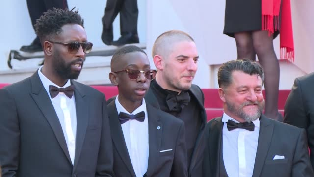 french director ladj ly who has been dubbed france's answer to spike lee walks the red carpet to present his first feature length film les miserables... - an answer film title stock videos & royalty-free footage