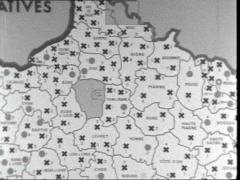 paris ministry of interior pan filmed map showing circles and crosses the circles indicate gaullist seats won crosses indicate seates yet to be... - peter snow stock-videos und b-roll-filmmaterial