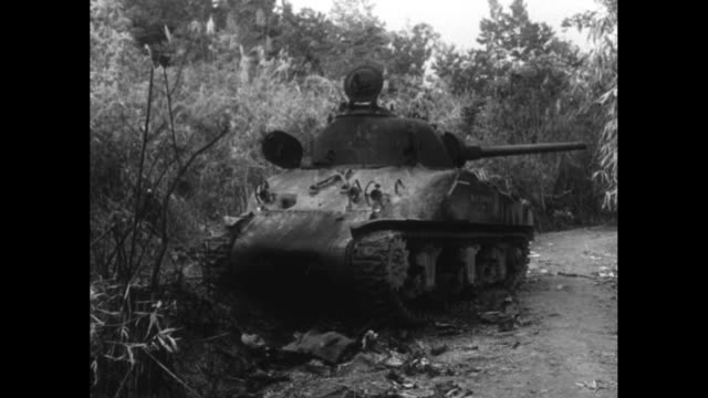 french far east expeditionary corps tank approaches with soldier standing in turret / vs pov from tank as it passes destroyed trucks / pov from tank... - indochina stock videos and b-roll footage