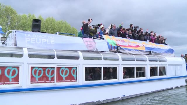 French farleft presidential candidate JeanLuc Melenchon meets supporters on a barge in a northeast suburb of the French capital for his latest quirky...