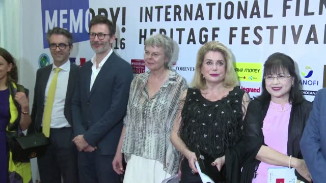 French film star Catherine Deneuve and director Michel Hazanavicius attend Friday's opening ceremony of the Memory International Film Heritage...