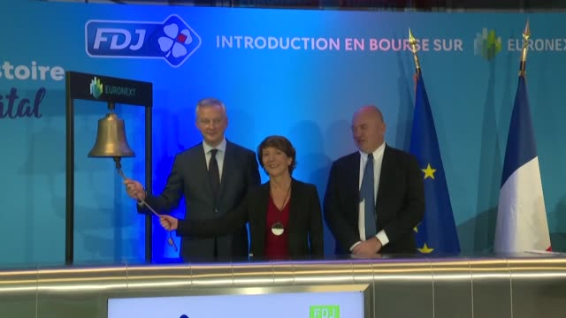 french finance minister bruno le maire rings the opening bell at the ceremony to float shares of france's state owned lottery monopoly française des... - paris stock exchange stock videos & royalty-free footage