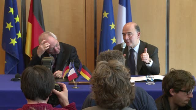 french finance minister pierre moscovici and his german counterpart, wolfgang schaeuble, explain a eurozone deal for the creation of a fund destined... - explaining stock videos & royalty-free footage