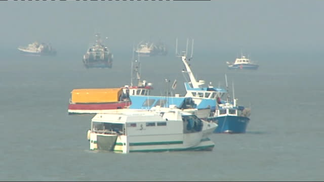 French fishermen end blockade of cross channel ports Ferries and traffic moving FRANCE Calais EXT French fishing boats and other vessels seen in the...
