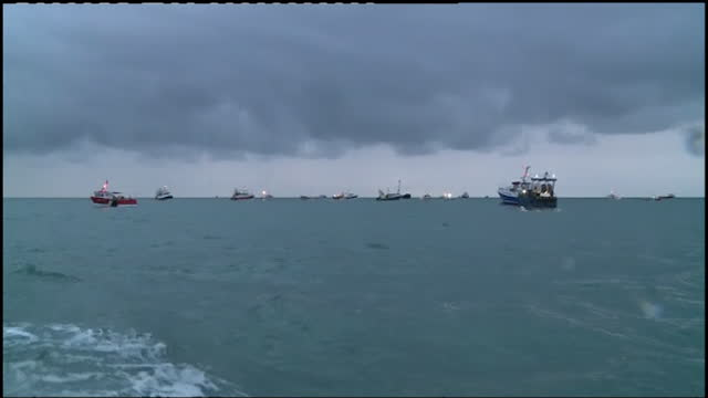 french fishing boats protesting oustide jersey's largest port over post brexit dispute to access to the waters, french naval patrol vessel in distance - leisure activity stock videos & royalty-free footage