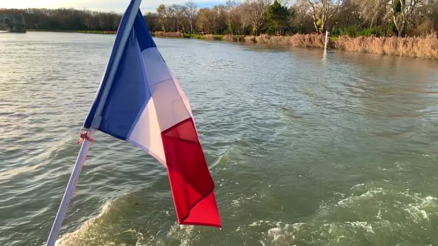 french flag over rhone river in sunset in avignon - rhone river stock videos & royalty-free footage