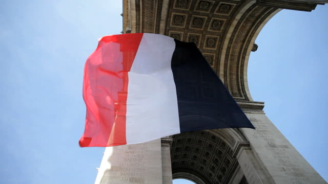 french flag under arc de triomphe built by napoleon, etoile, paris, france - french flag stock videos & royalty-free footage