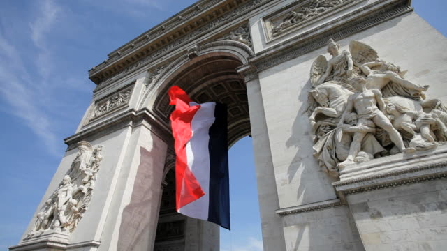 french flag under arc de triomphe built by napoleon, etoile, paris, france - arc de triomphe paris stock videos & royalty-free footage