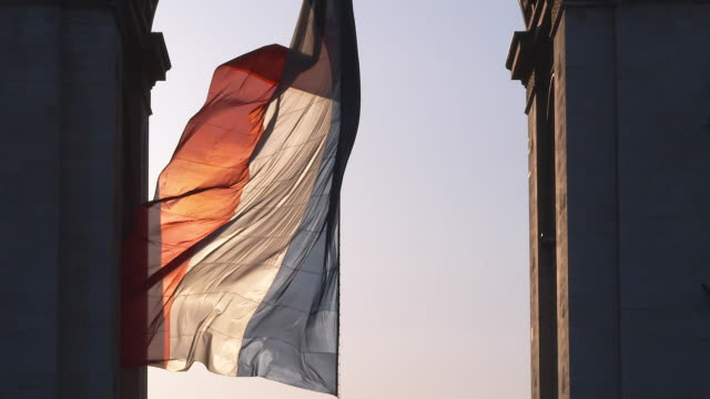 A French flag waves in a gentle breeze.