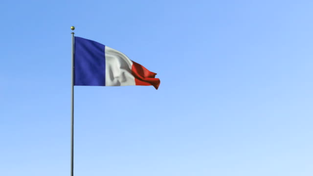 ws, french flag waving against blue sky - french flag stock videos & royalty-free footage
