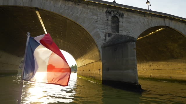 french flag waving in the sena river - tourboat stock videos & royalty-free footage