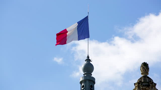 french flag waving in the wind / paris, france - national flag stock videos & royalty-free footage