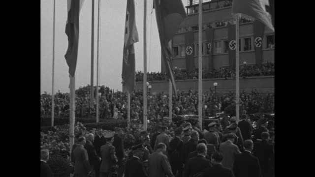 vídeos de stock, filmes e b-roll de french flags flutter in breeze in munich / adolf hitler and entourage walk on grounds of airport after meeting foreign dignitaries for conference at... - 1938