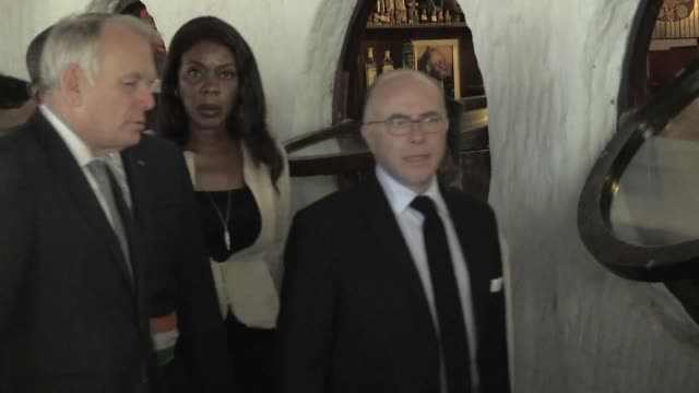 french foreign affairs and interior ministers jean marc ayrault and bernard cazeneuve visit the site of a beach attack in grand bassam which killed... - bernard cazeneuve stock videos & royalty-free footage