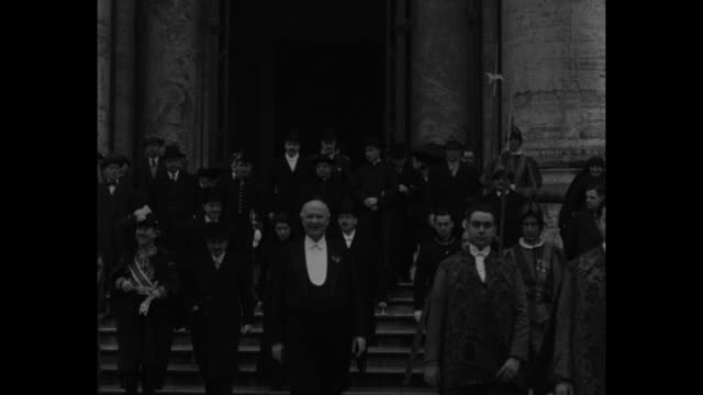VS French Foreign Minister Pierre Laval descends steps of Saint Peter's Basilica with daughter and large group after having met with Pope Pius XI /...