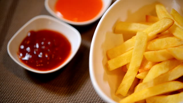French fries, fried yellow pepper sauce and ketchup.