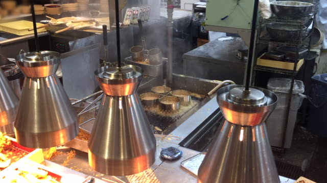 french fries frying on the table pan - fast food restaurant stock videos & royalty-free footage
