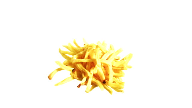 french fries spinning and rotating isolated on white background junk food suspended in the air - french food white background stock videos & royalty-free footage