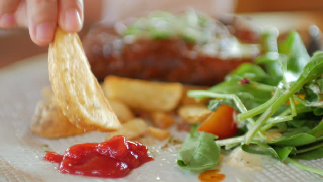 french fries with ketchup and salad , human hand take it. - unhealthy eating stock videos & royalty-free footage