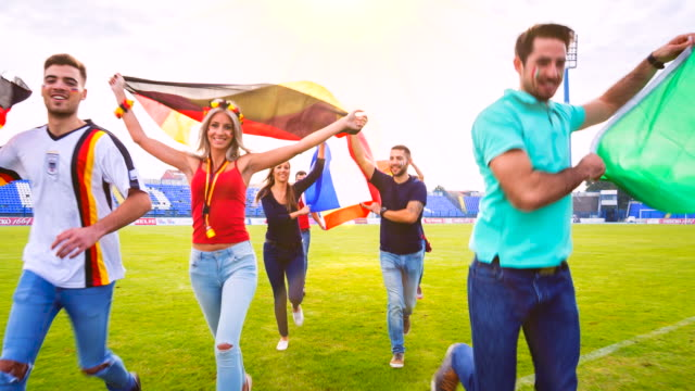 MS french, german, italian and spanish sport fans celebrating at soccer stadium