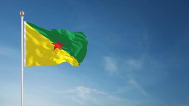4k french guiana flag - loopable - french guiana stock videos & royalty-free footage